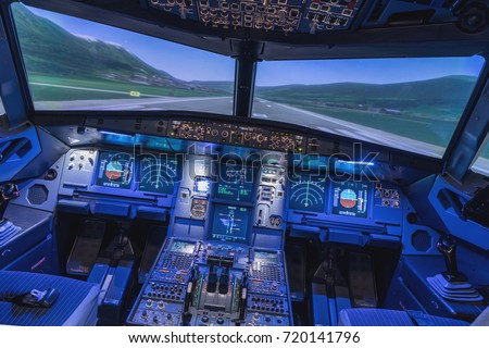 A view of the cockpit of a large commercial airplane, a cockpit trainer. Cockpit view of a commercial jaircraft cruising