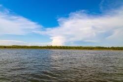 A view of the distant shoreline across the South Saskatchewan River