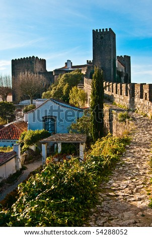 "A view of the fortified wall in Obidos, Portugal. The name ""Obidos"" probably derives from the Latin term oppidum, meaning ""citadel"", or ""fortified city"