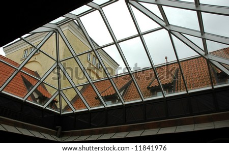 A view of the glass roof from inside an old castle #11841976