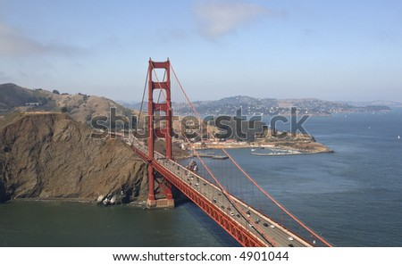 A view of the Golden Gate Bridge from the helicopter flying over, looking to Marin Headlands and Fort Mason.