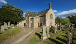 A view of the graveyard and church building in Aberlemno in Angus, Scotland