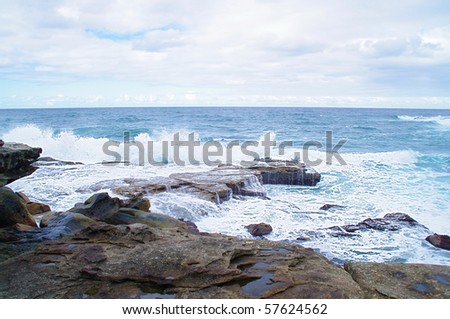 A view of the huge surf crashing on the cliffs around famous Bondi, Bronte and Tamarama beach, Australia