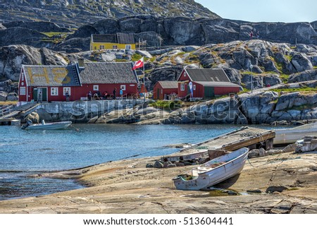 A view of the inner Bay with the port in the village of Oqaatsut. Midsummer Night. West Greenland #513604441