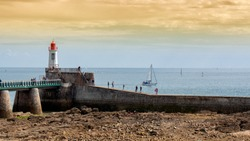 a view of the jetty and the lighthouse of Les Sables d'Olonne, France