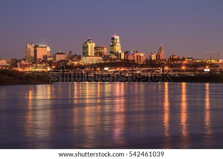 A view of the Kansas City skyline at twilight with reflections in the Missouri River