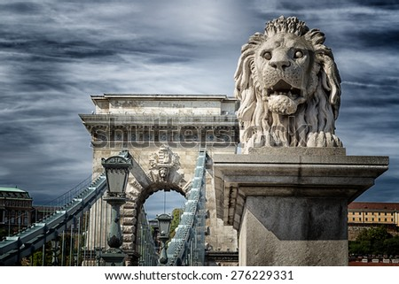 Stock Photo A  view of the Lion and the Chain Bridge on the Danube river in Budapest in Hungary.