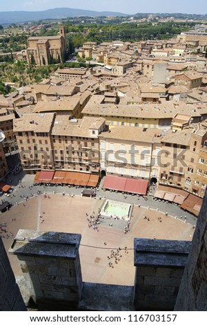 A view of the main square of the city of Siena and from the tower of the town hall