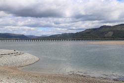 A view of the Mawddach Estuary and Barmouth bridge in Gwynedd, Wales, UK