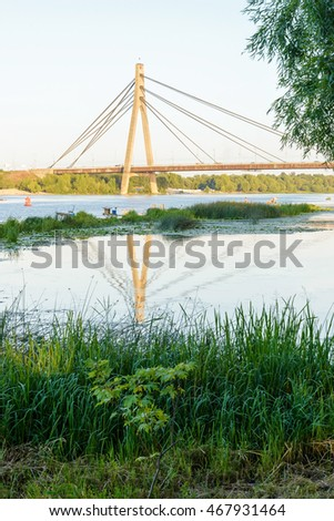 A view of the Moskovsky  bridge over the Dnieper river in Kiev, Ukraine, during a blue summer evening #467931464