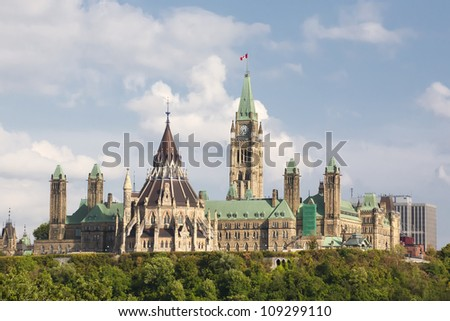 A view of the Parliament buildings in Ottawa, Ontario, including the Peace tower, the round library as well as east and west block.