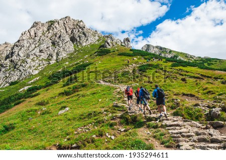 A view of the peaks Small Giewont and Giewont. Majestic mountain landscape in Tatras. Zakopane, Poland. Trekkers discover the world. Active lifestyle, sport and tourism.