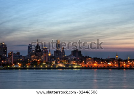 A view of the Philadelphia skyline at twilight with buildings illuminated.