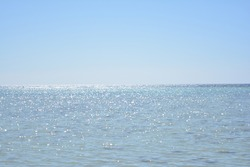 A view of the Red Sea on the shores of the city of Yanbu, Saudi Arabia at noon, and weibo shining sunlight