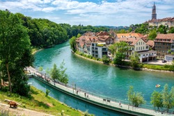 A view of the river Aare, BarenPark, a bear and the old town of Bern on a summer day, Bern, Switzerland