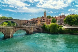 A view of the river Aare,  Untertorbrücke and Nydeggbrücke bridges, Nydeggkirche and the old town of Bern on a summer day, Bern, Switzerland