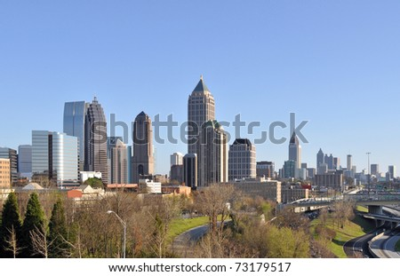 A view of the skyline of Atlanta, Georgia with midtown in the foreground and downtown in the background. - stock photo