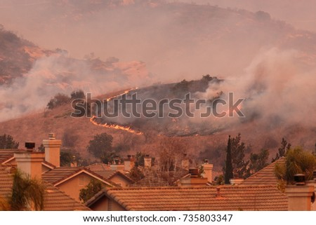 Shutterstock A view of the spreading flames from the Canyon Fire 2 wildfire in Anaheim Hills and the City of Orange