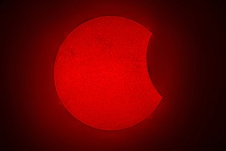 A view of the Sun during a Partial Solar Eclipse, an amazing view of our star shining in H Alpha light. An awe view of the astronomical evento from Santiago de Chile city