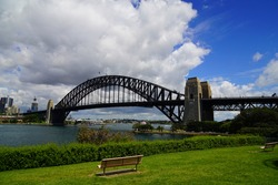 A view of the Sydney Harbor Bridge and the cityscape from the opposite bank of Sydney Bay, Australia