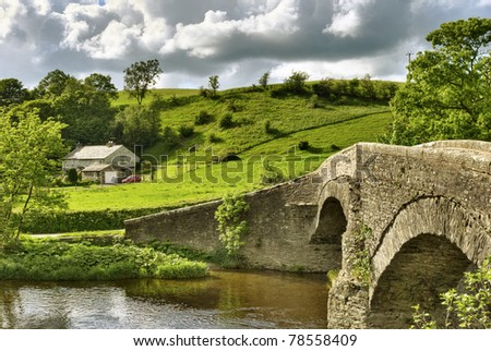 A view of the 16th century Packhorse bridge on the Dales Way at Lowgill, Cumbria.