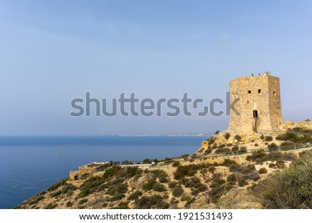 A view of the Torre de Santa Elena watchtower above the town of la Azohia in Murcia Stok fotoğraf ©