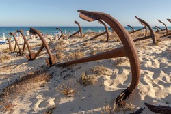 A view of the unique beach Praia do Barril in Portugal, where hundreds of rusty anchors rest in what is called the Cemitery of Anchors.