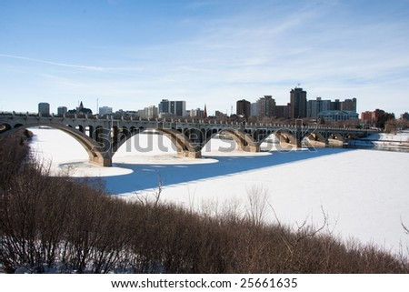 A view of the University Bridge and downtown Saskatoon, Canada on a sunny day in winter.