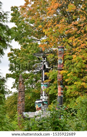 A view of Totem Poles in autumn time. Stanley park Vancouver Canada