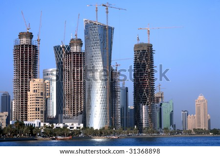 A view of towers unders construction in Doha, Qatar, on December 30, 2008. The Arabian Gulf emirate has been in the grip of a construction boom, fuelled by high energy prices