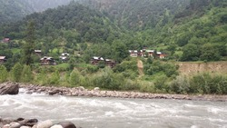 A view of Traditional Timber Homes along Line of Control/Cease Fire Line in Keran Valley, Indian Occupied Jammu & Kashmir pictured from River Neelum Bank at Keran, Neelum Valley Azad Jammu & Kashmir.