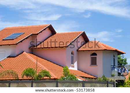 A view of typical vintage house with tile roof #53173858