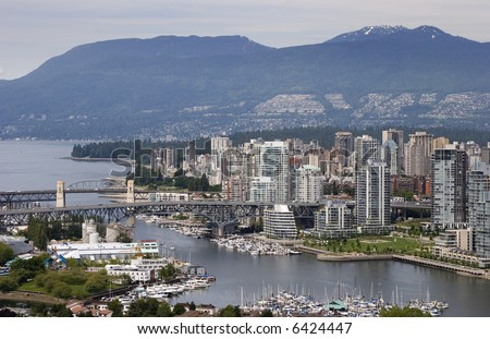 A view of Vancouver, British Columbia's West End. False Creek and English Bay are in the foreground, the Coastal Mountains in the background.