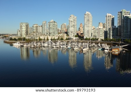 A view of Vancouver's Yaletown waterfront and marina in False Creek with new condominium towers along the shore. Vancouver, British Columbia, Canada.
