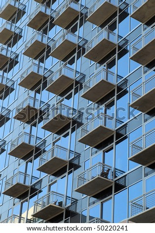 A view of window porches in an urban high rise