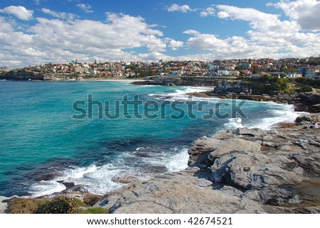 A view on Bronte Bay with beuatiful azure ocean and blue sky with clouds
