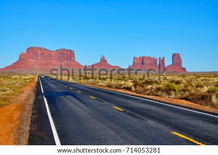 A view on the road that runs through Monument Valley, Arizona. - Shutterstock ID 714053281