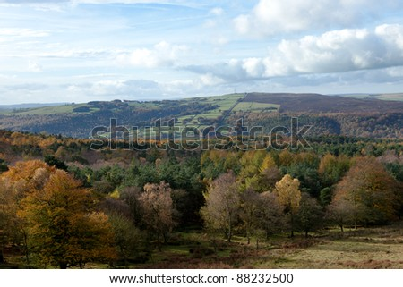 A view over an autumnal forest in the Peak District.