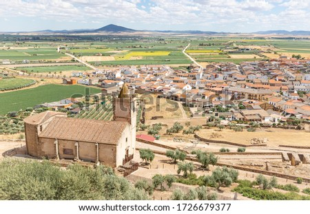 a view over Medellin town and the Santiago church in the foreground, province of Badajoz, Extremadura, Spain