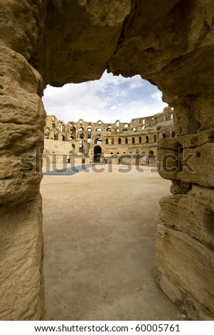 A view through an arch into the amphitheatre at El Jem in Tunisia