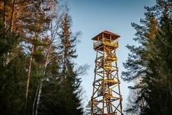 A viewing tower at the Blue Hills of Ogre. Latvia. Watchtower during sunset with trees.