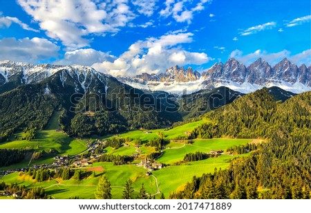 A village in a mountain green valley. Green valley village in mountains. Mountain green valley village. Mountain valley panorama
