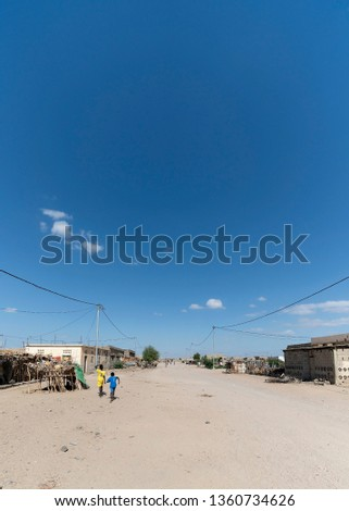 A village in Djibouti, signs of development as electricity and permanent structures are built. #1360734626