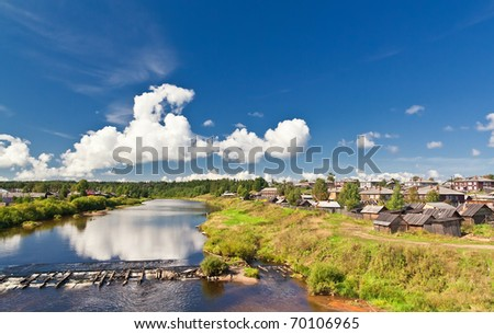 a village with a river landscape