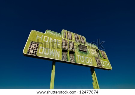 A vintage and dilapidated football scoreboard