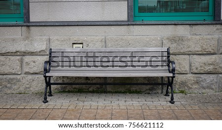 a vintage bench with stone wall ...