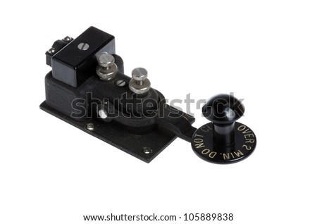 A vintage black telegraph key isolated on white - stock photo