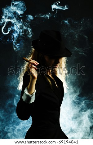 A vintage blond woman smoking a cigar isolated on dark background