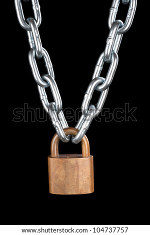 A vintage brass lock connecting a thick, chrome chain isolated on black.