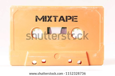 A vintage cassette tape from the 1980s era (obsolete music technology) with the text Mixtape printed over it (my addition, not in the original image). Color: cream, sand. White background.
